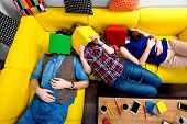 picture of sleeping  - Sleeping and tired young students felt sleep after work on the yellow couch - JPG