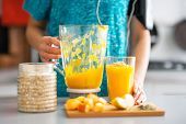 Close-up On Fitness Young Woman With Pumpkin Smoothie In Kitchen