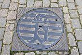 image of manhole  - Bruges emblem on manhole cover - JPG