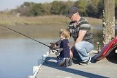 picture of dock a lake  - father and son fishing on dock - JPG