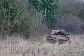 pic of panzer  - Tank from russia camouflaged near a forest - JPG