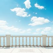 clouds in blue sky over balcony