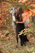 Pretty Woman With Appaloosa Horse In Autumn