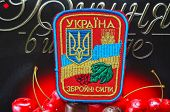 Kiev,Ukraine.Dec 20.Illustrative editorial. Chevron of Ukrainian Army.With logo Roshen Inc. Trademark Roshen is property of ukrainian president Poroshenko.At December 20,2014 in Kiev, Ukraine