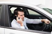 Angry businessman on the phone in his car