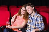 Young couple watching a film at the cinema