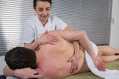 Man Is Getting Back Massage From A Physiotherapist