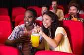 stock photo of cinema auditorium  - Young people watching a film at the cinema - JPG