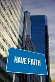 The word have faith and blue billboard against low angle view of skyscrapers