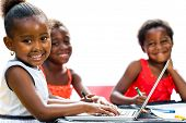 Threesome African Kids With Laptop At Table.