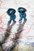 pic of united we stand  - toy ETs standing on a Map of the United States with the words Nevada test Site on the map