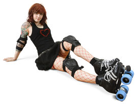 stock photo of roller-derby  - Photograph of a roller derby girl posing on the floor with her equipment - JPG