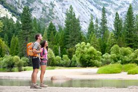 image of nationalism  - Hiking people on hike in mountains in Yosemite - JPG