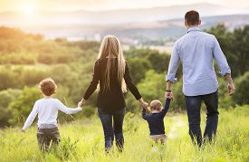 picture of father child  - Happy young family spending time together outside in green nature - JPG