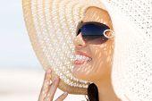 stock photo of sunbathing woman  - Portrait of a woman wearing hat sunbathing - JPG