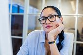 picture of thoughtfulness  - Thoughtful businesswoman sitting at her desk in the office - JPG