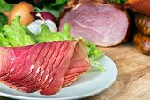 foto of smoked ham  - collage of different kinds of meat smoked ham with schwarzwald or prosciutto - JPG