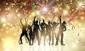 stock photo of confetti  - Silhouettes of people dancing on a background with confetti and streamers - JPG