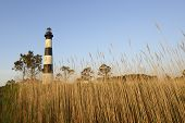 image of marshes  - Bodie Lighthouse on the Outer Banks of North Carolina at sunrise - JPG