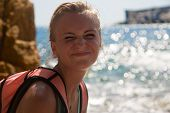 stock photo of wild adventure  - Adventure girl smiling happy on the wild coast - JPG