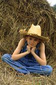 Boy By Hay Bale