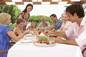 picture of extend  - Extended Family Group Enjoying Outdoor Meal Together - JPG