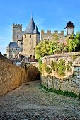 foto of cobblestone  - Historic fortress of Carcassonne behind arched cobblestone lane France - JPG
