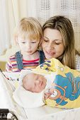 foto of maternal  - portrait of mother with her daughters in maternal hospital - JPG