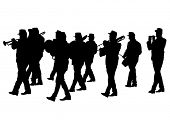 stock photo of wind instrument  - Men walking with a brass instrument - JPG