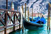 pic of gondola  - Gondola on the Grand Canal pier in Venice - JPG