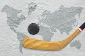 foto of hockey arena  - Hockey stick and puck on the ice with the image of a world map - JPG