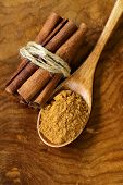 picture of cinnamon sticks  - fragrant cinnamon sticks and ground spices on a wooden background - JPG