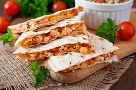 stock photo of sandwich wrap  - Mexican Quesadilla wrap with chicken - JPG