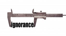 stock photo of ignore  - Color horizontal shot of a caliper and measuring the word  - JPG