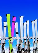 skis on snow covered place in winter with mountains in the distance