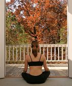 Woman Doing Yoga Looking Outside