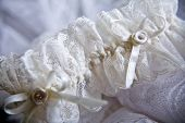 Lace wedding garter partly out of focus horizontal