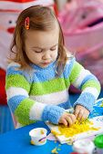 Little girl learning in her nursery at home