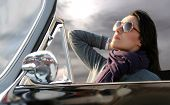 image of snob  - portrait of beautiful woman sitting in a vintage car - JPG