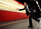 Business man loosing the train