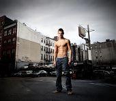 muscular guy in a city street