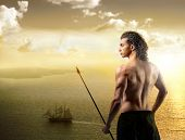 Beautiful warrior with seascape on the background