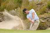 Golfer Plays Green Side Bunker Shot