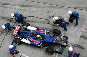 Sepang, MALAYSIA - 21 November: Pit crew of Team Great Britain in action at the World A1 GP champion