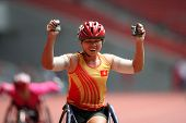 KUALA LUMPUR - AUGUST 15: Vietnam's wheel chair athlete wins the 800m race at the track and field ev