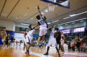 KUALA LUMPUR - DECEMBER 13: KL Dragons defends an attack by Thailand Tigers in the ASEAN Basketball