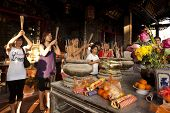 MALACCA - FEBRUARY 16: Devotees pray at the Cheng Hoon Teng Temple during Chinese New Year celebrati