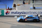 SEPANG, MALAYSIA - JUNE 21: The Calsonic Impul GTR Nissan car (12) taking the checkered flag winning