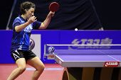 KUALA LUMPUR, MALAYSIA - SEPTEMBER 24: Krisztina Toth, Hungary (ITTF World Rank 21) plays a topspin lob at the Volkswagen 2010 Women's World Cup in table tennis on September 24, 2010 in Kuala Lumpur.