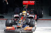 KUALA LUMPUR - APRIL 2: McLaren's driver Lewis Hamilton exits the garage for his practice lap on pra